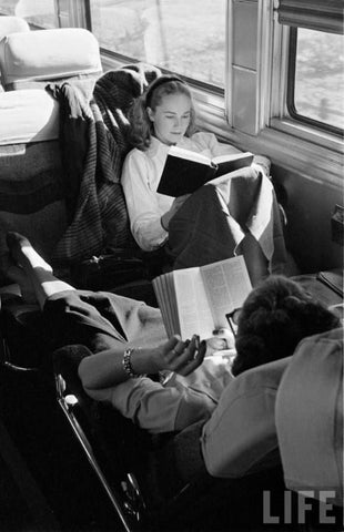 couple reading on a train