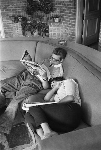 couple sleeping and reading together