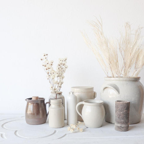 stoneware crocks with dried florals