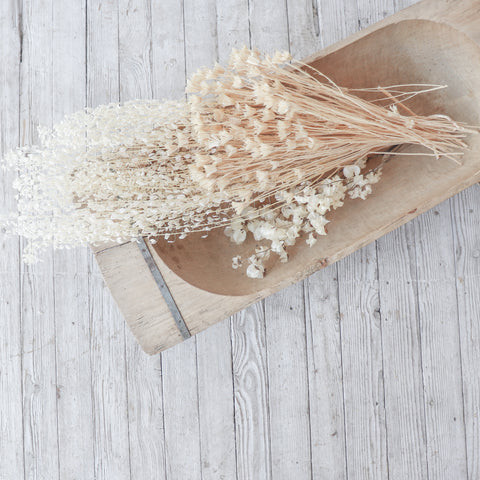 dried florals in wooden bowl