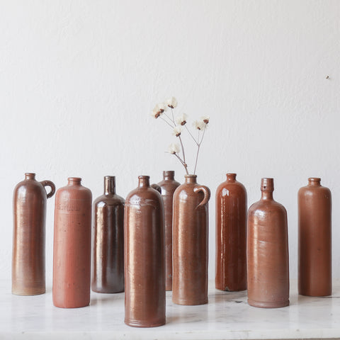 vintage stoneware bottles with dried florals