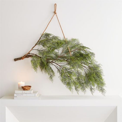 evergreen branch hanging over fireplace