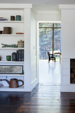 floating farmhouse hallway with bookshelves