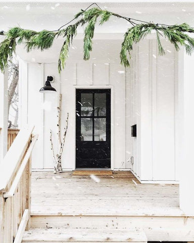 snowy entry with garland