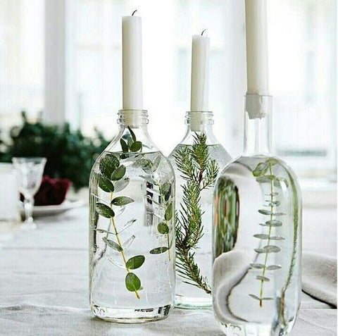greens in bottles with taper candles