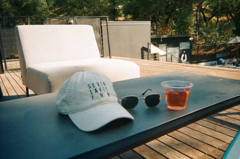 hat and cocktail at the pool autocamp yosemite