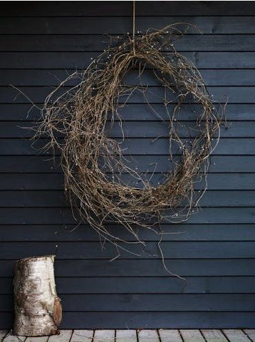 black house with rustic wreath