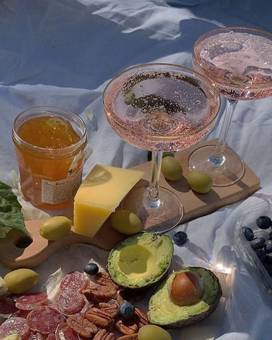 sparkling wine in coupes summer picnic