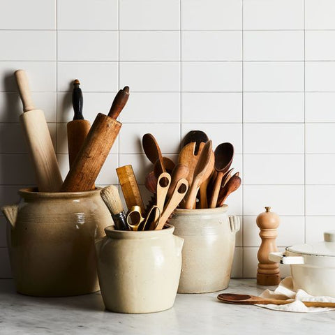stoneware crocks with wood spoons