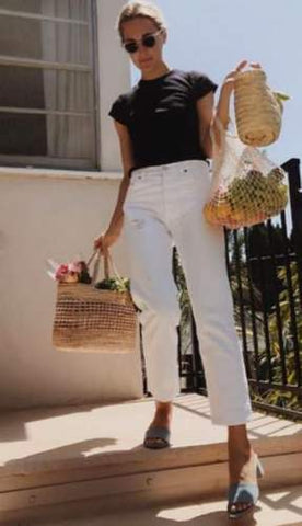 woman in white jeans and t shirt