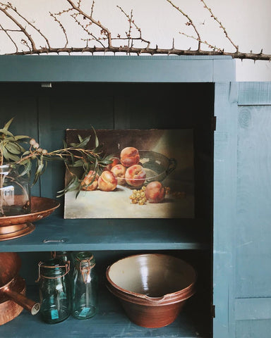 vintage armoire with art