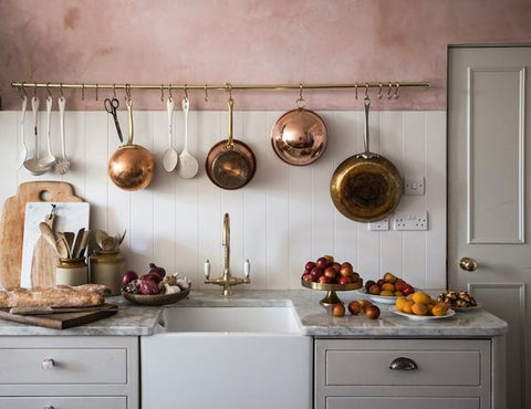 vintage copper on pink wall