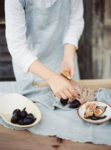 woman baking with figs