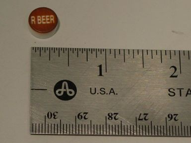 PH10-74-139: Root Beer Brown Button with White Letters