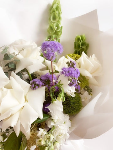 arrangement of flowers with white roses
