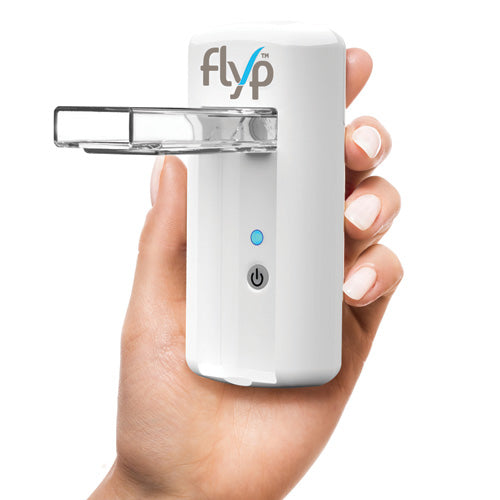 A women's hand holding Flyp Portable Nebulizer