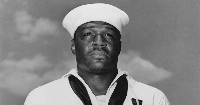 During the attack on Pearl Harbor, this black sailor broke all the rules to save lives.