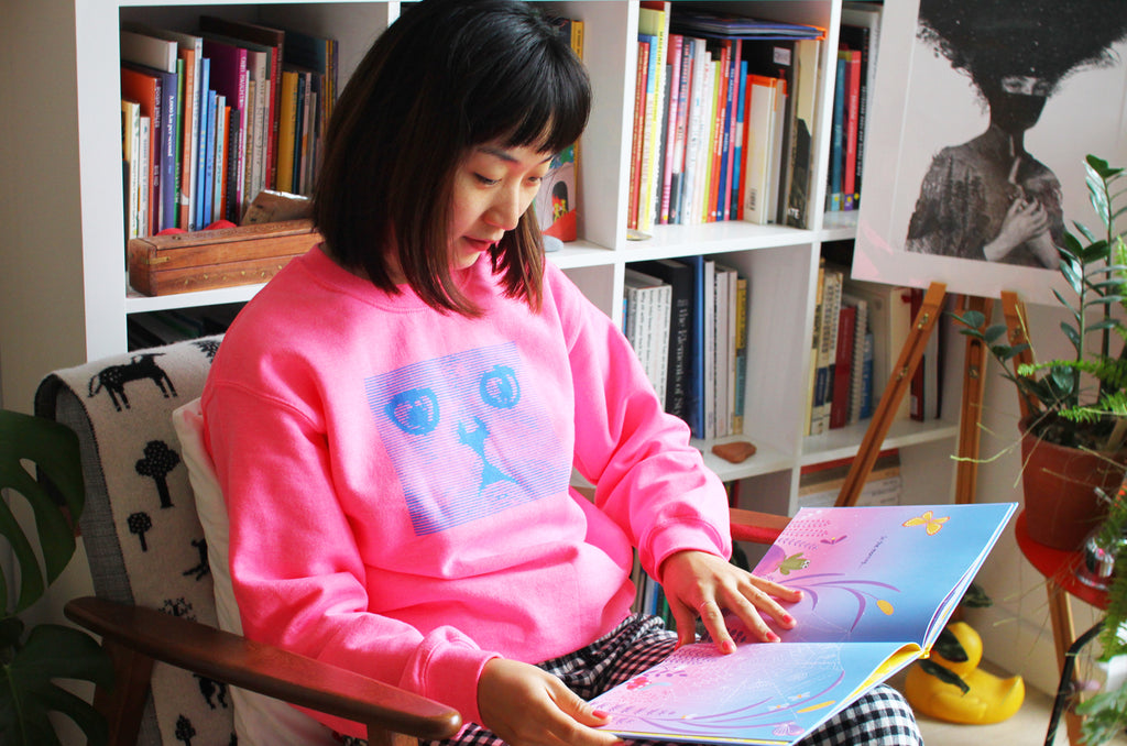 Qian reading her illustrated book