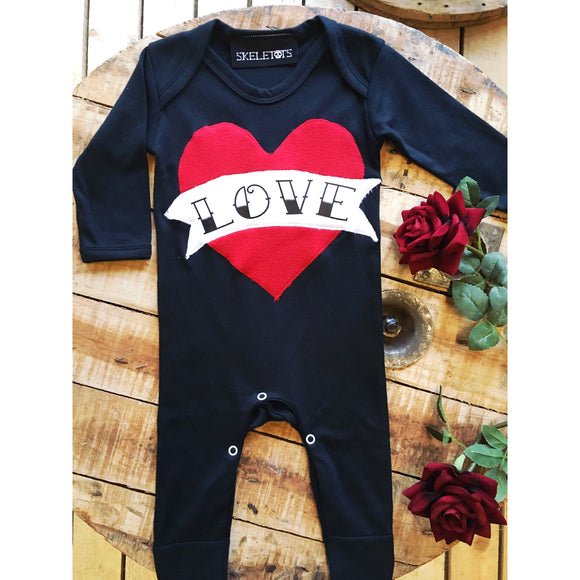 Skeletots black romper with tattoo love scroll