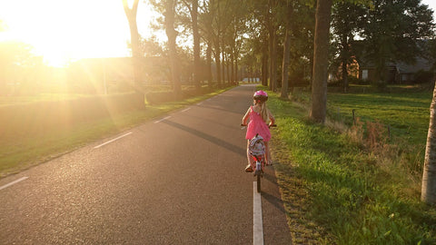 Girl riding bike to school