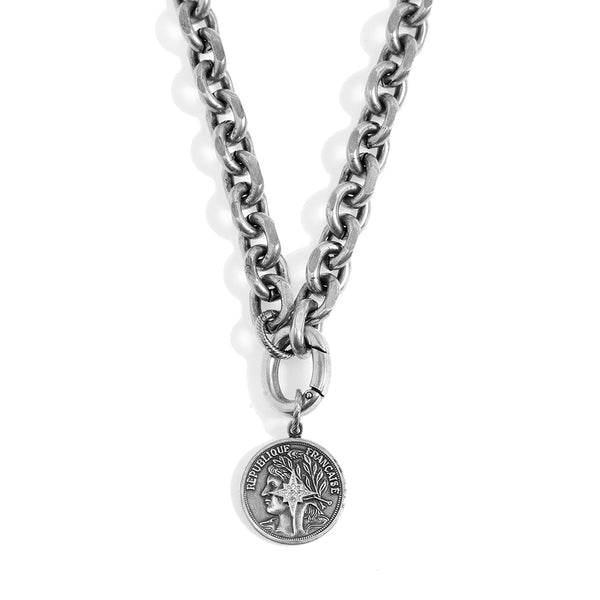 Blackened Silver Necklace with a Coin Star Pendant
