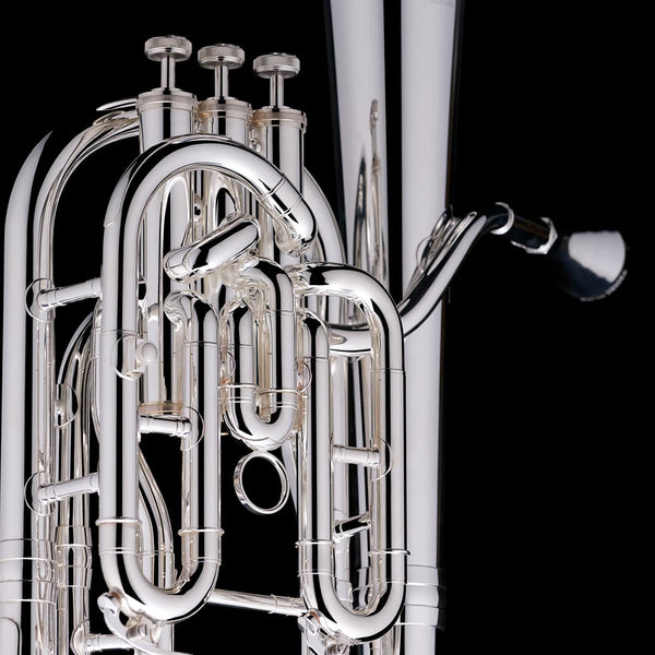 A close up image of the piston valves of a Bb Compensated Baritone (3-valve) from Wessex Tubas in silver-plate