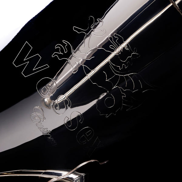 A close up image of the detailed engraving on the bell of a Eb Sousaphone (4-valve) from Wessex Tubas