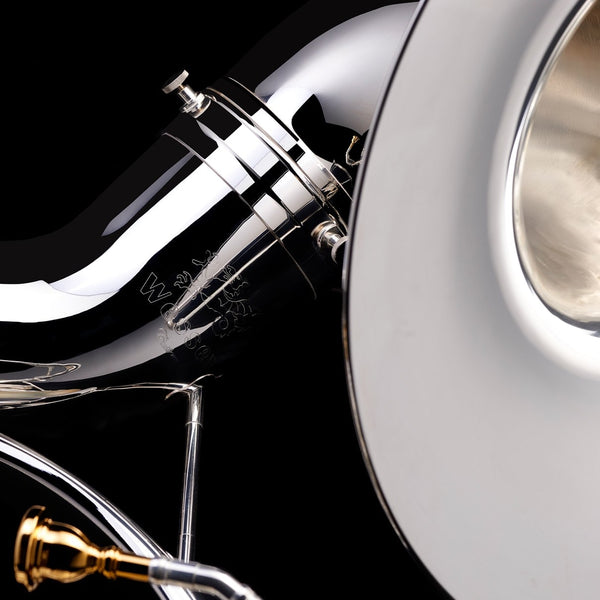 A close up image of the engraving on, and mouthpiece of, a Eb Sousaphone (4-valve) from Wessex Tubas