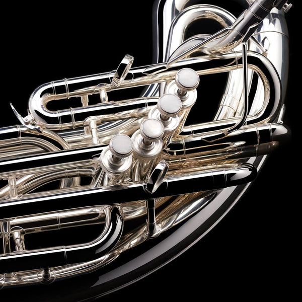 A close up image of the piston valves on a Eb Sousaphone (4-valve) from Wessex Tubas in silver