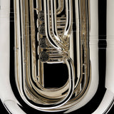 A close up image showing the detailed engravings on the valves of a BBb 6/4 Rotary tuba 'Kaiser' from Wessex Tubas
