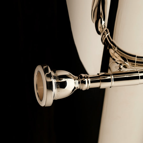 A close up image of the mouthpiece of a Eb Front Piston Compensated Tuba 'Cavalry' in silver-plate from Wessex Tubas