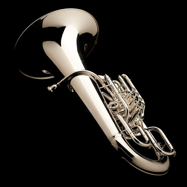 An image of a Eb Front Piston Compensated Tuba 'Cavalry' in silver plate from Wessex Tubas laying flat