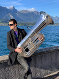 An image of Will Druiett holding a BBb 6/4 Rotary tuba 'Kaiser' from Wessex Tubas