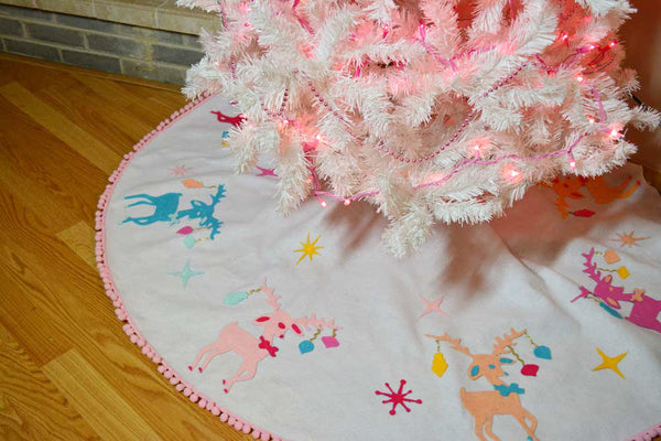 Finished holiday tree skirt under Christmas tree