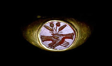 A gold betrothal ring of ancient Rome depicting the image of clasped hands
