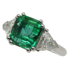 4.11ct. Emerald Three Stone Ring set Two Trillion Diamonds set in Platinum custom designed and manufactured by David Saad of Skyjems.ca