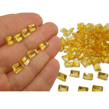 7 Stones - 10.5 ct Citrine 8x6mm Octagon
