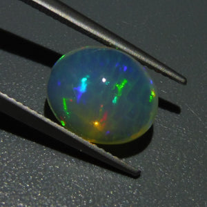 Opal 3.85 cts 12.16x10.12x6.77mm Oval Cabochon Base Color: Very Slightly Yellow  $60