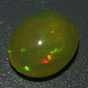 Opal 2.75 cts 12.14x9.93x5.55mm Oval Cabochon Base Color: Yellow  $40