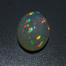 Opal 7.01 cts 15.51x11.17x8.09mm Oval Cabochon Base Color: Slightly Off White  $245
