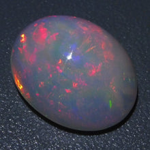 Opal 6.3 cts 15.60x12.48x7.22mm Oval Cabochon Base Color: White  $220