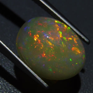 Opal 4.35 cts 14.24x11.54x6.08mm Oval Cabochon Base Color: Off White  $150