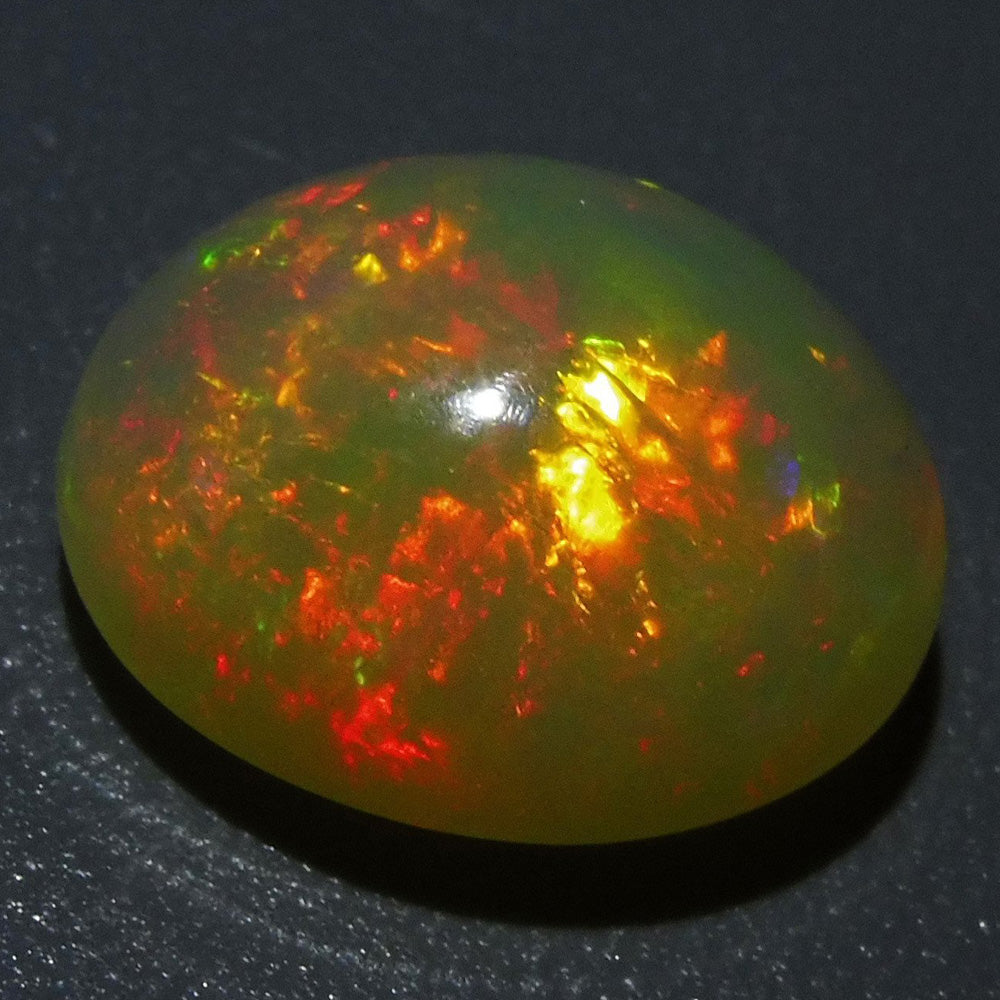 Opal 6.31 cts 15.07x12.60x7.71mm Oval Cabochon Base Color: Yellow  $220