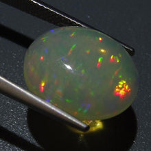 Opal 4.89 cts 14.86x13.12x5.25mm Oval Cabochon Base Color: Slightly Yellow  $170