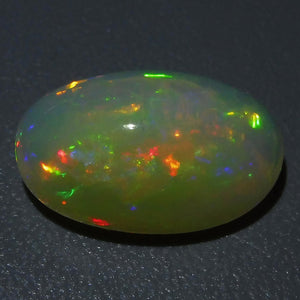 Opal 6.84 cts 16.81x10.94x7.96mm Oval Cabochon Base Color: Slightly Orangey Yellow   $240
