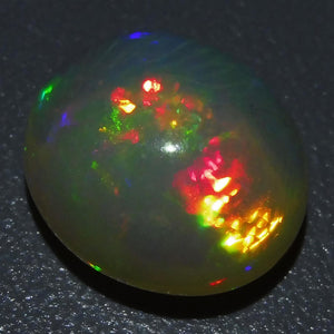 Opal 6.1 cts 14.07x12.25x7.97mm Oval Cabochon Base Color: Slightly Yellowish Orange  $215