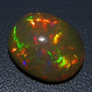 Opal 5.44 cts 14.07x11.64x6.52mm Oval Cabochon Base Color: Yellowish Orange  $190