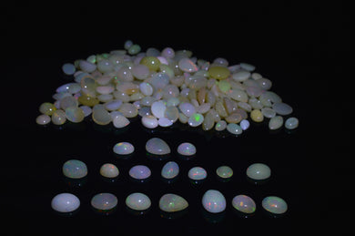 Opal 142.84 cts 184 stones Wholesale Lot