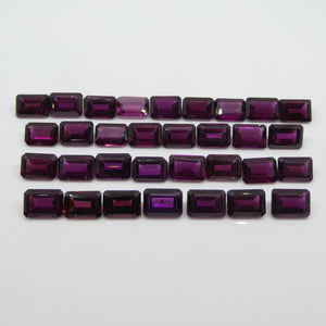 Rhodolite Garnet 86.09cts 7.00x5.00x3.30mm Emerald Cut Range: Purple - Red Purple $180