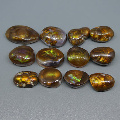 Mexican Fire Agate 90.33cts 12.91x8.44x5.03 to 20.08x11.88x6.06mm Freeform Reddish-brown base, with flashes of orange, red, green and gold $300